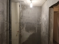 Вид санузла после штукатурки стен