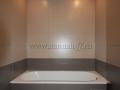 Интерьер ванной комнаты после укладки плитки